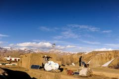 Solar power panels bring light and connectivity into homes in Afghanistan.