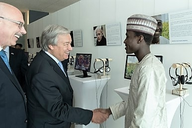SG Guterres and USG Voronkov greet Imrana Buba, victims exhibit 20180817