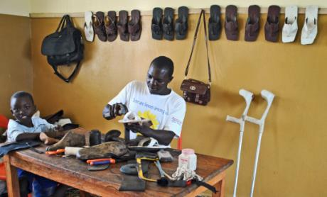 Stricken with polio at age 10, Umaru Kargbo now supports his family as a shoemaker. Credit: UNDP Sierra Leone