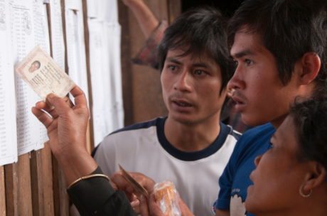 Indigenous people verify their names on a voter list in Mondul Kiri Province, Cambodia. Credit: UNDP/ Alejandro Boza
