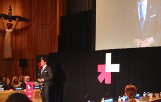 The Youth Envoy, Ahmad Alhendawi, standing on stage and addressing the audience at He for She