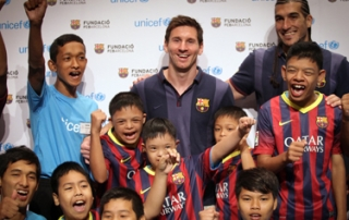 FC Barcelona player and UNICEF Goodwill Ambassador Leo Messi and FC Barcelona player José Manuel Pinto, with children who participated in an event held in Thailand to promote social inclusion for young people living with disabilities.