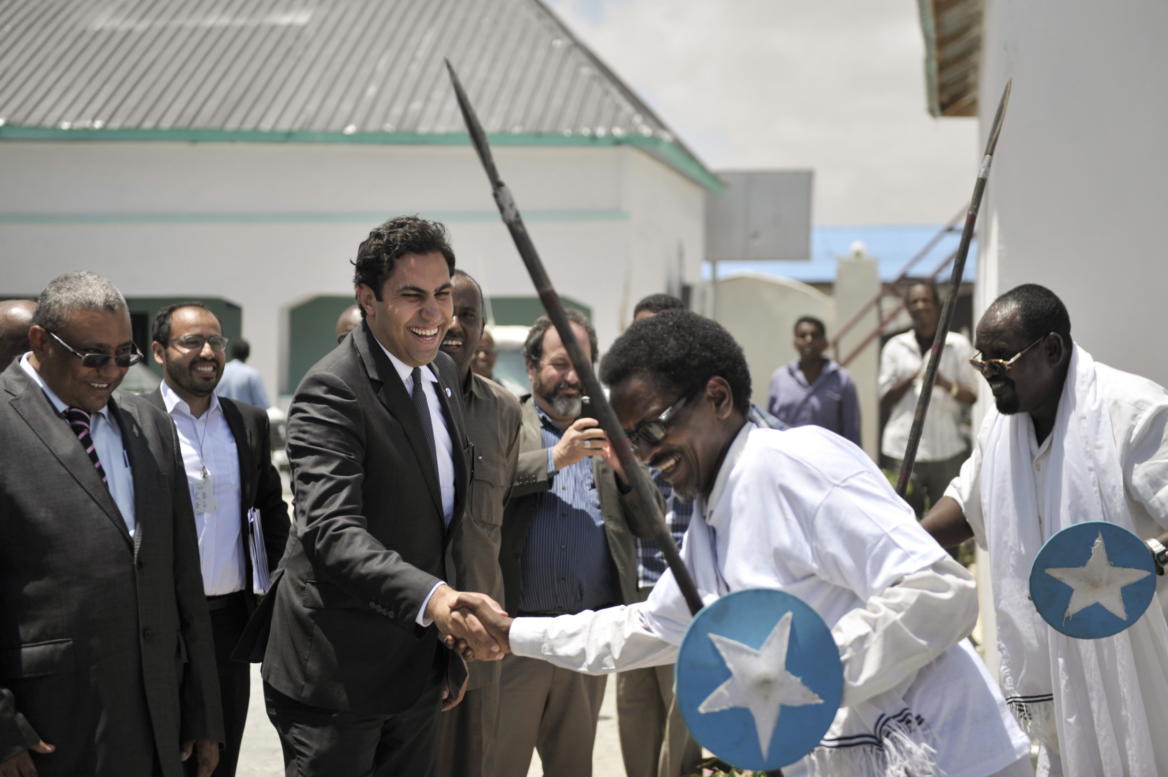 Envoy on Youth, Ahmed Alhendawi, is greeted at the Ministry of Youth by Somali dancers in Mogadishu