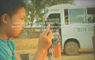 A boy focuses his camera behind text inviting youth to apply to the PEACEapp competition