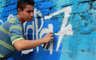 """A member of a neighbourhood collective focusing on youth inclusion in Ibagué, Colombia, takes part in the #RespiraPaz (""""Breathe Peace"""") campaign 