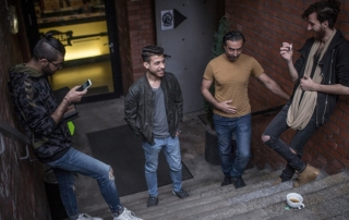 Musiqana band members Alaa Zaitouna, Abdallah Rahal, Adel Sabawi and Ali Hasan take a break from practicing. The four Syrian refugees are delighting German audiences with traditional Arabic music. © UNHCR/Daniel Morgan