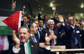 the Palestinian delegation celebrates in the General Assembly